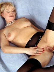 Blonde naughty grandma unveils it all