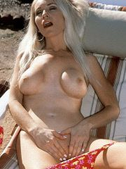 Blonde MILF nude by the pool