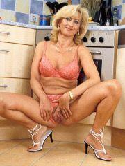 Milfie masturbating in the kitchen