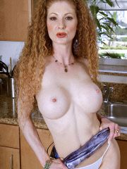 Redhead MILF with big tits and puffy nipples