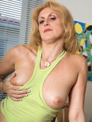 Horny woman in 50s gets naughty in home office