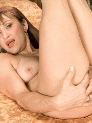 Hot grandma spreads her pussy lips