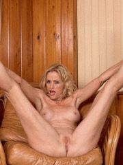 Hard bodied blonde spreads pussy