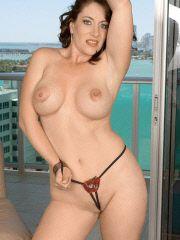 Hot MILF nude on high rise balcony