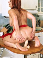 Mature babe works the kitchen