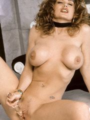 Hot babe playing with glass dildo