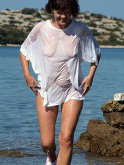 Outdoor pictures of nude, mature exhibitionists, nudist..