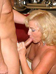 Blonde milf spreads her ass cheeks..