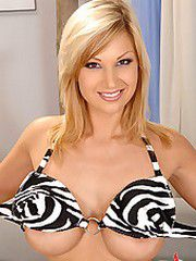 Busty blonde Carol shows off
