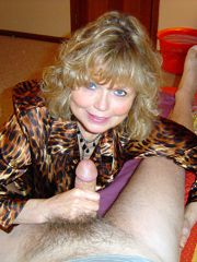 Cute blonde milf having fun by a dick and sucks it and..