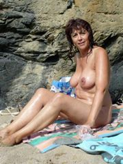 Naked middle-aged woman on the nudists beach