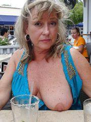 Sexy granny flash tits in..