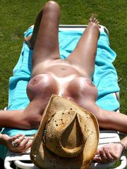 Naked mature nudist sunbathing naked on the beach