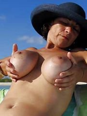 Busty mature exposing her charms, her nice pussy need your..