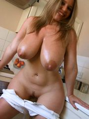 Lush and luxurious lady exposing her curves in the kitchen