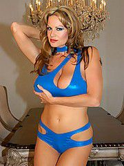 Kelly and her big boobs in a sexy blue outfit.