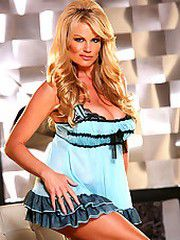 Kelly in a blue lacey teddy takes it..