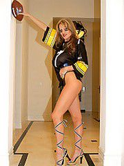 Kelly Madison posing in a Steelers jersey.