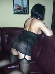 Brunette milf posing in black lingerie,..