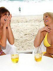 Sexy beach booty lesbian milfs fuck their bikini pussies..