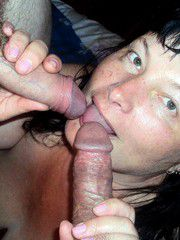 Swinger mature fox takes two cocks in mouth