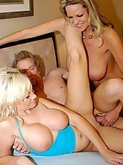 Two tanning beauties take a huge cock that squirts a load..