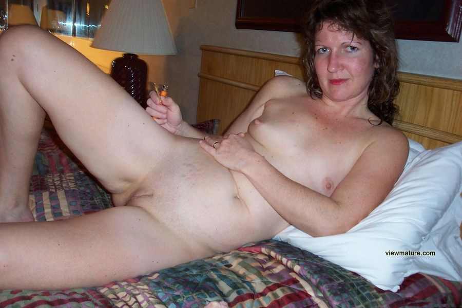Mature wife in kitchen