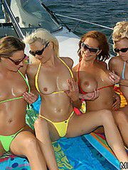 4 crazy hot milfs go out on a yacht to get down and dirty in the sea