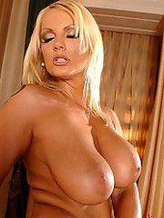 Big boobed blonde dildoing