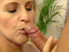 Blonde granny in stockings gets anal fucked on sofa