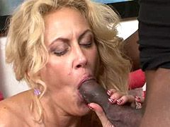 Blonde mature in black stockings gets fucked