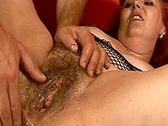 Older redhead whore exposes hairy beaver ang gets fucked