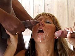 Mature babe sucking two cocks and getting hard double..