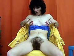 Old brunette mature toying hairy hole on chair by yelow..