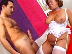 Horny mature woman in white stockings fucked doggystyle on bed