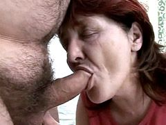Redhead granny with big tits gives blowjob and fucking in hairy cunt