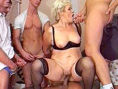 Granny babe sucking and fucking hard cocks gangbang
