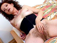 Mature whore exposes hairy beaver ang gets interacial fucked