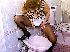 Hairy mature woman hardcore fucked on floor of bathroom