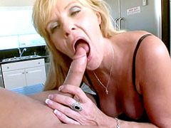 Sexy blonde mature in black stockings gets young dick in..