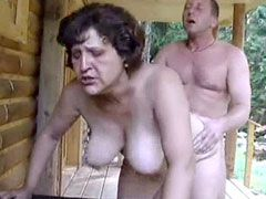Mature shows big tits and jerking young cock ouydoor