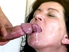 Brunette mature slut in black stockings play with cocks..