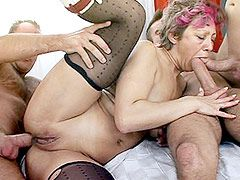 Horny granny in black stockings gets banged in hardcore..