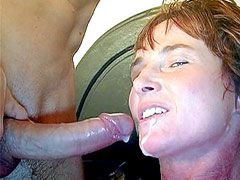 Redhead mature babe in black stockings gets hard cock in..