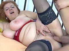 Busty mature in black stockings sucks huge dick and fucking
