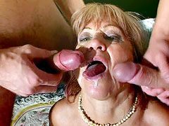Big tits granny slut sucking two cocks and getting wild..
