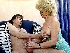 Blonde old granny undressing for hard action with young guy