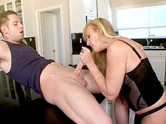 Blonde housewife in black stockings sucking and jumping on cock