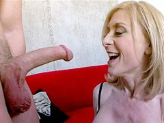 Busty mature blonde getting fucking on sofa for facial cum