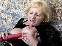Busty granny babe doggystyle fucked on sofa and gets tity cum
